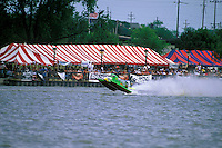 Frame 2: Halfway around the first lap, Wyatt Nelson (#39) blows the boat over crashing back to the water. Nelson was unhurt in the crash. (SST-120 class) Bay City, MI 1998