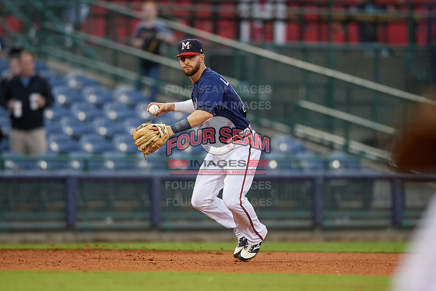 Mississippi Braves third baseman Daniel Lockhart (17) throws to first base during a Southern League game against the Jacksonville Jumbo Shrimp on May 4, 2019 at Trustmark Park in Pearl, Mississippi.  Mississippi defeated Jacksonville 2-0.  (Mike Janes/Four Seam Images)