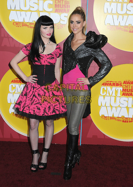 Susie Brown & Danelle Leverett of JaneDear Girls.2011 CMT Music Awards held at Bridgestone Arena, Nashville, Tennessee, USA..June 8th, 2011.full length pink black grey gray silver print jacket dress hand on hip.CAP/ADM/LF.©Laura Farr/AdMedia/Capital Pictures.