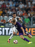 Calcio, Serie A: Juventus vs Fiorentina. Torino, Juventus Stadium, 20 agosto 2016.<br /> Juventus&rsquo; Dani Alves, left, and Fiorentina&rsquo;s Marcos Alonso fight for the ball during the Italian Serie A football match between Juventus and Fiorentina at Turin's Juventus Stadium, 20 August 2016. Juventus won 2-1.<br /> UPDATE IMAGES PRESS/Isabella Bonotto