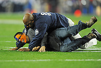 Jan. 4, 2010; Glendale, AZ, USA; A Boise State Broncos fan is tackled by security after running on the field in the second quarter against the TCU Horned Frogs in the 2010 Fiesta Bowl at University of Phoenix Stadium. Boise State defeated TCU 17-10. Mandatory Credit: Mark J. Rebilas-