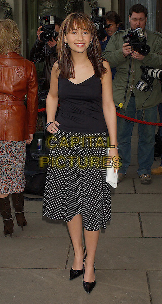 SAMIA GHADIE.Attending the Television & Radio Industries Club Awards (TRIC) at Le Meridian, Grosvenor House, London..March 9th 2004.full length full-length white clutch bag black polka dot skirt fringe.Ref: BEL.www.capitalpictures.com.sales@capitalpictures.com.©Capital Pictures