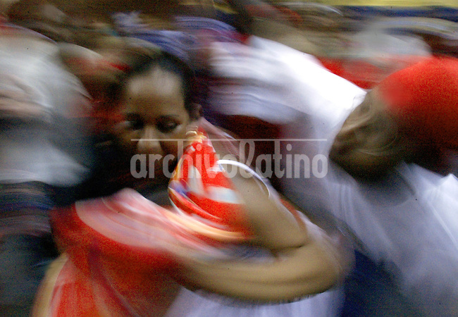 The Venezuela´s dance while celebrate the 'Dia de San Juan' (St. John's Day), a festival which draws on European and African roots in the village of Curiepe, in Northern Venezuela, 75 miles of Caracas, late June 25, 2004. The festival starts when the saint is brought out from the church and ends after three days of non-stop drumming, singing, dancing and drinking. Howard Yanes