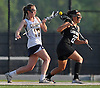 Massapequa No. 17 Madeline Lee, left, and Farmingdale No. 22 Alexis Campo battle for possession of a faceoff during a Nassau County varsity girls' lacrosse semifinal at Adelphi University on Tuesday, May 19, 2015. Farmingdale won by a score of 11-7.<br /> <br /> James Escher