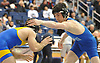 John Colletti of Long Beach, right, battles Andre Cunha of East Meadow at 138 pounds during the Nassau County Division 1 wrestling quarterfinals at Hofstra University on Saturday, Feb. 13, 2016. Colletti won the tightly contested match by decision 3-2.