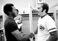 Cincinnati Reds catcher Johnny Bench congratulates Oakland Athletics pitcher Vida Blue in the dressing room after the A's defeated the Reds in the 1972 World Series. (photo/Ron Riesterer)