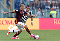Calcio, Serie A: Roma vs Juventus. Roma, stadio Olimpico, 30 agosto 2015.<br /> Roma&rsquo;s Radja Nainggolan, left, is challenged by Juventus&rsquo; Stefano Sturaro during the Italian Serie A football match between Roma and Juventus at Rome's Olympic stadium, 30 August 2015.<br /> UPDATE IMAGES PRESS/Riccardo De Luca
