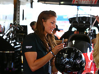 Apr 27, 2014; Baytown, TX, USA; A fan gts a helmet autographed by NHRA top fuel dragster driver Leah Pritchett during the Spring Nationals at Royal Purple Raceway. Mandatory Credit: Mark J. Rebilas-