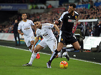(L-R) Ashley Williams of Swansea challenges Etienne Capoue of Watford during the Barclays Premier League match between Swansea City and Watford at the Liberty Stadium, Swansea on January 18 2016
