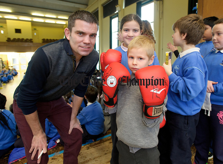 Former WBA Super bantamweight champion Bernard Dunne, a Carambola Kids ambassador,  with young boxer Andy Endijs Anderson during his visit to The Holy family school in Ennis to promote the importance of healthy eating and physical fitness. Photograph by John Kelly.