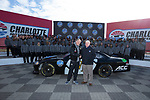 Wake Forest Demon Deacons head coach Dave Clawson shakes hands with Will Webb, Executive Director of the Belk Bowl, as the football team poses for a group photo at the Charlotte Motor Speedway on December 26, 2017 in Concord, North Carolina.  (Brian Westerholt/Sports On Film)