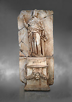 Roman Sebasteion relief sculpture of Krete Aphrodisias Museum, Aphrodisias, Turkey.  Against a grey background.<br /> <br /> The classical hairstyle, dress and pose characterises the figure of civilised and free,