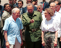 Photo File/The former President of U.S. Jimmy Carter (L) ,Cuban Presiden Fidel Castro (C) and Carter's Rosalynn Carter during ceremony farewell,  May 17/2002 in the International airport José Marti of Havana. Carter carries out a historical visit of 6 days to the communist island, where he/she met with you lead of several parties of the opposition. Credit: Jorge Rey/MediaPunch