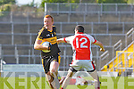 Johnny Buckley  Dr Crokes powers past Eoin Lawlor Rathmore  during their Club Championship semi final on Sunday