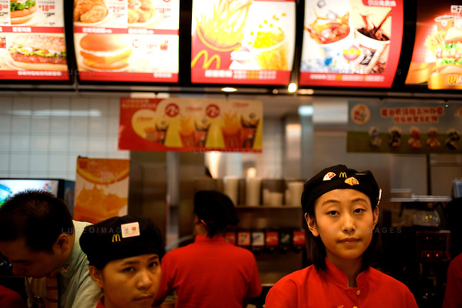 Workers at McDonald's, one of the official sponsors of the Games, in Beijing, China on Sunday, August 10, 2008.  Kevin German