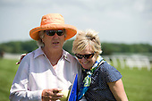 Gil Johnston, left, and Kathy McKenna celebrate Embarrassed's fourth race win at Fair Hill.
