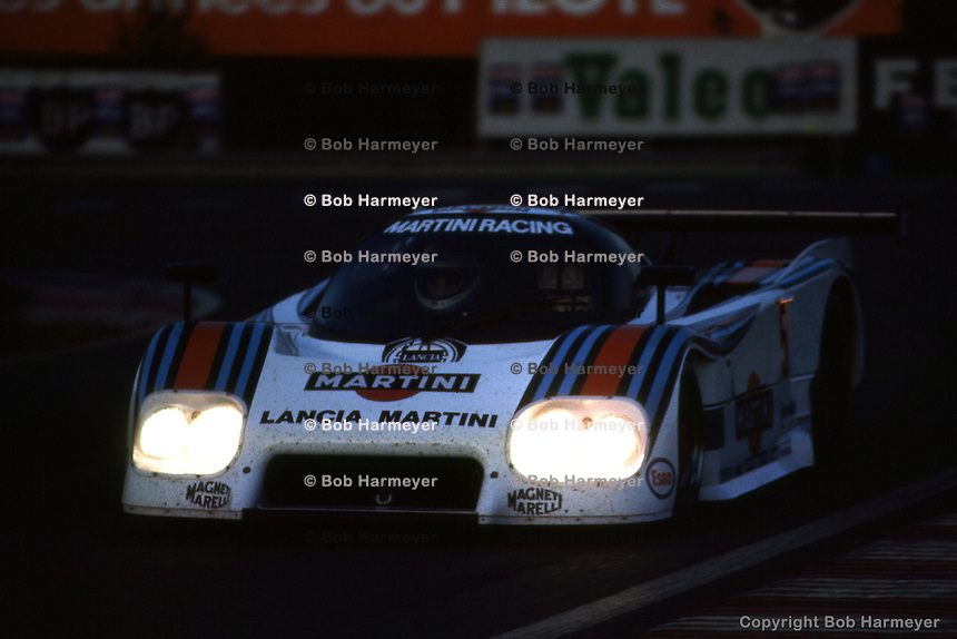 LE MANS, FRANCE: The Martini Racing Lancia LC2-84 0003 of Hans Heyer, Mauro Baldi and Paolo Barilla leaves the Mulsanne Corner during the 24 Hours of Le Mans at Circuit de la Sarthe in Le Mans, France, on June 17, 1984.