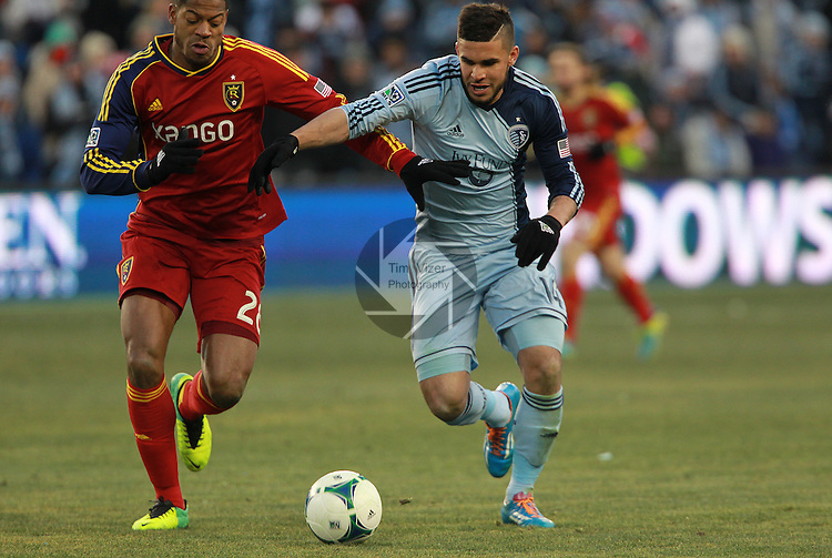 Real Salt Lake defender Chris Schuler (28, left) and Sporting KC forward Dom Dwyer (14) battle for the ball in the second half. Sporting KC defeated Real Salt Lake in a shootout after the score was tied 1-1 at the end of regulation play in the MLS Cup 2013 championship held at Sporting Park in Kansas City, Kansas on Saturday December 7, 2013.