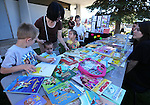 Marina Crounk and her children select books at the Summer Reading Program Pancake Breakfast Kick-Off at the Carson City Library, in Carson City, Nev., on Saturday, June 8, 2013. <br /> Photo by Cathleen Allison