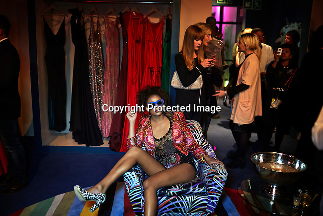 CAPE TOWN, SOUTH AFRICA - JULY 26:  A model sits in a chair during an installation show at the new Klûk CGDT flagship store during Mercedes-Benz Fashion Week on July 26, 2014, in Cape Town, South Africa. Klûk CGDT, created by the designers Malcolm KLûK and Christiaan Gabriel Du Toit. The elite of Cape Town came out for the launch of the store and the late night party. (Photo by Per-Anders Pettersson)