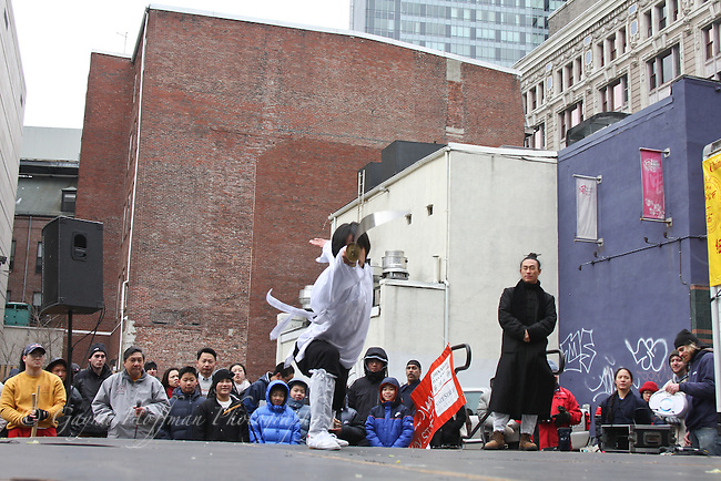 Man performing martial arts for Chinese New Year celebration.