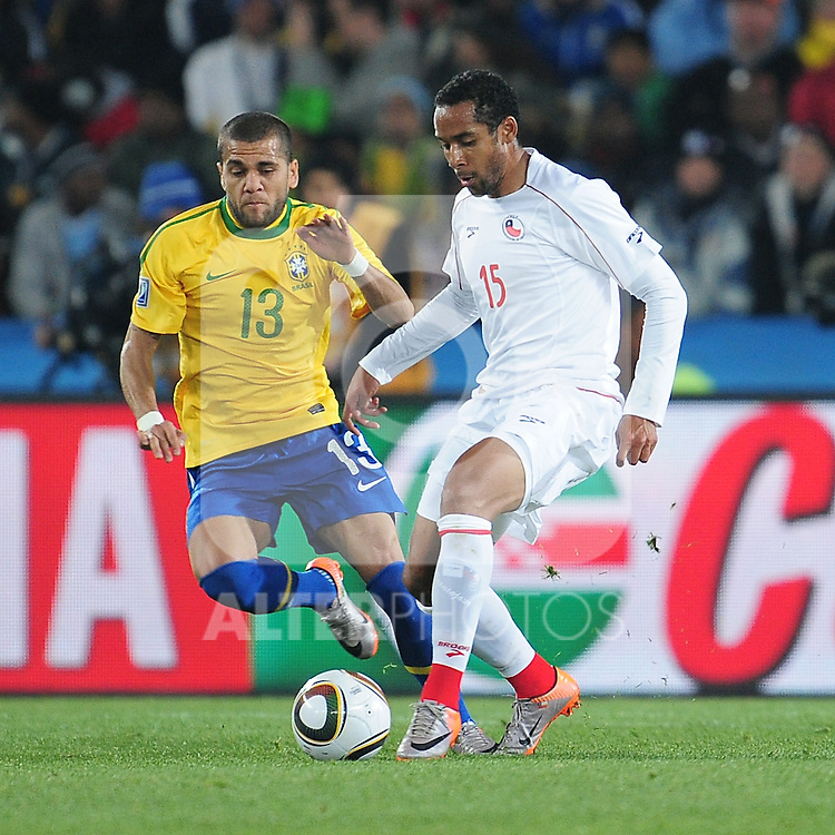 Dani Alves defends for BRazil during the 2010 FIFA World Cup South Africa Round of Sixteen match between Brazil and Chile at Ellis Park Stadium on June 28, 2010 in Johannesburg, South Africa.