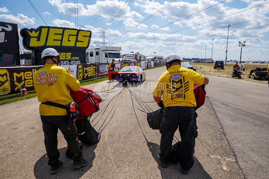 Jul 8, 2017; Joliet, IL, USA; Members of the NHRA safety safari roll up the parachutes for pro stock driver Dave River during qualifying for the Route 66 Nationals at Route 66 Raceway. Mandatory Credit: Mark J. Rebilas-USA TODAY Sports