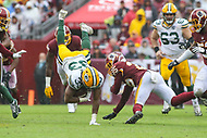 Landover, MD - September 23, 2018: Green Bay Packers running back Aaron Jones (33) gets tackled by Washington Redskins defensive back Montae Nicholson (35) during the  game between Green Bay Packers and Washington Redskins at FedEx Field in Landover, MD.   (Photo by Elliott Brown/Media Images International)