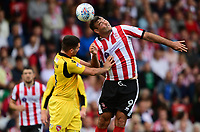 Lincoln City's Matt Rhead vies for possession with Morecambe's Alex Kenyon<br /> <br /> Photographer Chris Vaughan/CameraSport<br /> <br /> The EFL Sky Bet League Two - Lincoln City v Morecambe - Saturday August 12th 2017 - Sincil Bank - Lincoln<br /> <br /> World Copyright &copy; 2017 CameraSport. All rights reserved. 43 Linden Ave. Countesthorpe. Leicester. England. LE8 5PG - Tel: +44 (0) 116 277 4147 - admin@camerasport.com - www.camerasport.com