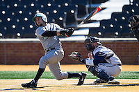 Sergio Leon (4) of the Marshall Thundering Herd follows through on his swing against the Georgetown Hoyas at Wake Forest Baseball Park on February 15, 2014 in Winston-Salem, North Carolina.  The Thundering Herd defeated the Hoyas 5-1.  (Brian Westerholt/Four Seam Images)
