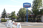 The investigation continues into a shooting rampage at an IHOP restaurant in Carson City, Nev., Sept. 7, 2011. Four people were killed and seven others injured before the gunman killed himself Tuesday. (AP Photo/Cathleen Allison)
