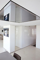 Partitions are used in this apartment to change the configuration of the living spaces
