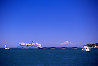 A BC Super Ferry, leaving Active Pass in the Southern Gulf Islands, en route to the Tsawwassen Ferry Terminal, British Columbia, Canada, with Mt. Baker, in Washington State, USA, on the Horizon