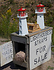 Small lighthouse replicas for sale in the small fishing village of Neils Harbour, Nova Scotia. Photo by Kevin J. Miyazaki/Redux