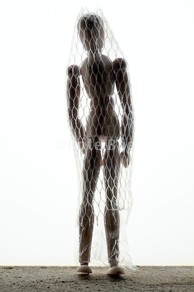 wooden mannequin figure with plastic net covering