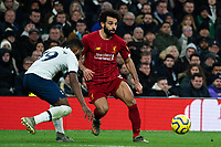 Liverpool's Mohamed Salah crosses the ball despite the attentions of Tottenham's Japhet Tanganga <br /> <br /> Photographer Stephanie Meek/CameraSport<br /> <br /> The Premier League - Tottenham Hotspur v Liverpool - Saturday 11th January 2020 - Tottenham Hotspur Stadium - London<br /> <br /> World Copyright © 2020 CameraSport. All rights reserved. 43 Linden Ave. Countesthorpe. Leicester. England. LE8 5PG - Tel: +44 (0) 116 277 4147 - admin@camerasport.com - www.camerasport.com