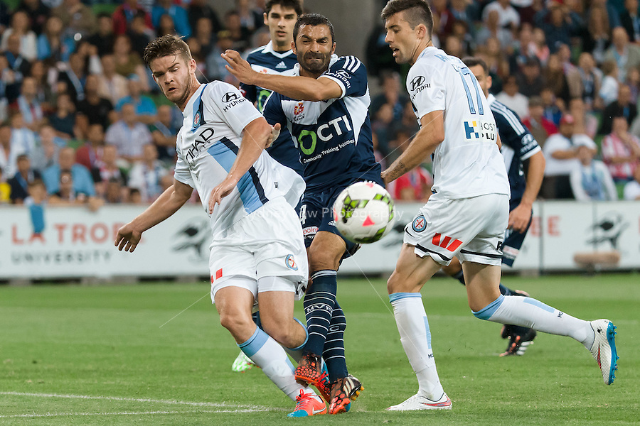 Connor CHAPMAN of Melbourne City and Fahid BEN KHALFALLAH of the Victory fight for the ball in round 11 A-League match between Melbourne City and Melbourne Victory at AAMI Park in Melbourne, Australia during the 2014/2015 Australian A-League season. City def Victory 1-0