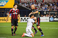 A. C. Milan goalkeeper Christian Abbiati (32) pats Cristiano Ronaldo (7) of Real Madrid on the head after the two collided . Real Madrid defeated A. C. Milan 5-1 during a 2012 Herbalife World Football Challenge match at Yankee Stadium in New York, NY, on August 8, 2012.