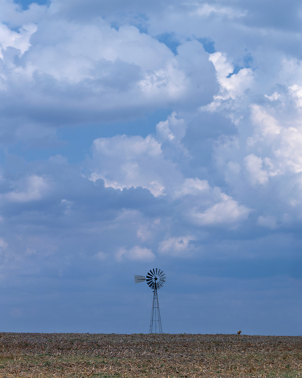 Windmill and cloud formations on a ranch in Fayette County, TX