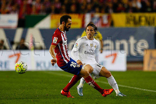 04.10.2015. Madrid, Spain.  Luka Modric (19) Real Madrid. Juan Francisco Torres Belen (20) Atletico de Madrid. La Liga match  between Atletico de Madrid and Real Madrid at the Vicente Calderon stadium in Madrid, Spain, October 4, 2015.