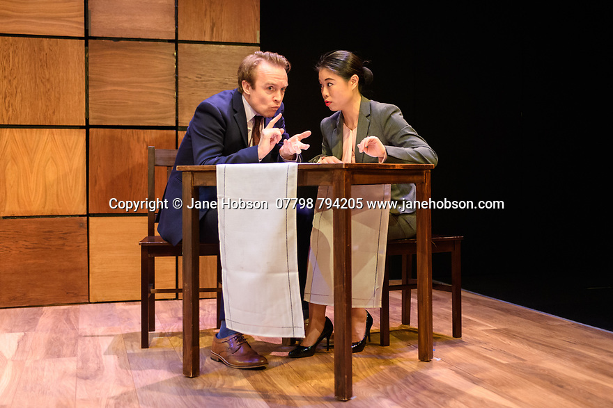 "London, UK. 22.03.2017. ""CHINGLISH, by David Henry Hwang, opens at the Park Theatre. Directed by Andrew Keates, with lighting design by Christopher Nairne and set and costume design by Tim McQuillen-Wright. Picture shows:  Gyuri Sarossy (Daniel), Candy Ma (Xi Yan). Photograph © Jane Hobson."
