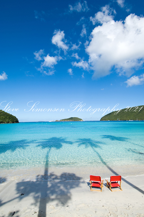 Red beach chairs at Maho Beach, St. John.Virgin Islands National Park