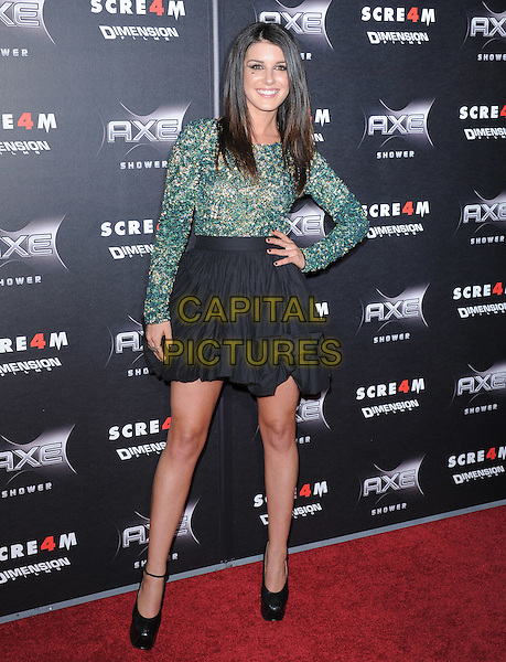 SHENAE GRIMES .at the Weinstein World Premiere of 'Scream 4' held at The Grauman's Chinese Theatre in Hollywood, California, USa, April 11th 2011..full length hand on hip dress skirt  shoes platform ankle strap  ruched black heart on cheek face smiling make-up beauty green print  beaded top patterned .CAP/RKE/DVS.©DVS/RockinExposures/Capital Pictures.