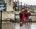 VMI Vincentian Heritage Tour: Soggy wedding scene in downtown Paris, France during the Vincentian Heritage Tour with cohort members from the Vincentian Mission Institute. (DePaul University/Jamie Moncrief)
