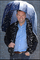 BNPS.co.uk (01202 558833)<br /> Pic: Rainshader/BNPS<br /> <br /> ***Please use full byline***<br /> <br /> Stephen Collier with his reinvention of the brolley.<br /> <br /> A wet day out at the Grand National last year has led to British inventor Stephen Collier reinventing the umbrella.<br /> <br /> Stephen was so depressed by his soaking wet visit to Aintree that he set his mind to creating an umbrella that would not poke peoples eyes out or turn inside out at the first puff of wind.<br /> <br /> Now after extensive research and even a visit to a wind tunnel Stephen's revolutionary design is set to go on sale.<br /> <br /> The Rainshader will cost &pound;24.99 but will last a lot longer than some of the flimsy versions on sale today.