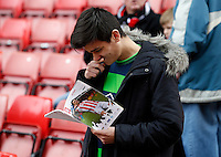 A Swansea fan reads his program during the Barclays Premier League match between Stoke City and Swansea City played at Britannia Stadium, Stoke on April 2nd 2016