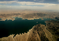 Lake Mead, which seperates Arizona, bottom, and Nevada, top, is seen from the air, Sunday May 1, 2005, east of Las Vegas. Interior Secretary Gale Norton is expected to announce, Monday May 2, 2005, the May-to-September water allotment for the seven Colorado River basin states that rely on the river for drinking water and power. Upper-basin states Colorado, Utah, Wyoming and New Mexico argue heavy rainfall in the Southwest this winter has raised the water level in Lake Mead enough to justify cutting theannual allotment of water through Glen Canyon Dam to speed refilling Lake Powell. (AP Photo/Joe Cavaretta)