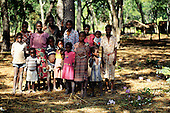 Livingstone Memorial, Zambia. Group of local people standing under the trees.