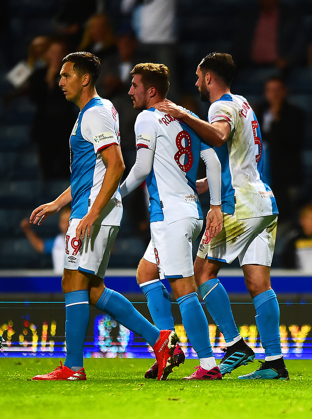 Blackburn Rovers' Joe Rothwell is congratulated by team-mate Greg Cunningham after scoring his side's third goal<br /> <br /> Photographer Richard Martin-Roberts/CameraSport<br /> <br /> The Carabao Cup First Round - Tuesday 13th August 2019 - Blackburn Rovers v Oldham Athletic - Ewood Park - Blackburn<br />  <br /> World Copyright © 2019 CameraSport. All rights reserved. 43 Linden Ave. Countesthorpe. Leicester. England. LE8 5PG - Tel: +44 (0) 116 277 4147 - admin@camerasport.com - www.camerasport.com
