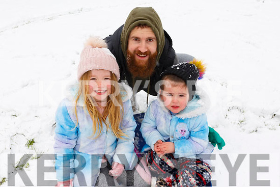 Enjoying the snow in Shanakill on Friday last. L-r, Greg and Hayley Powell and Ava Canty.